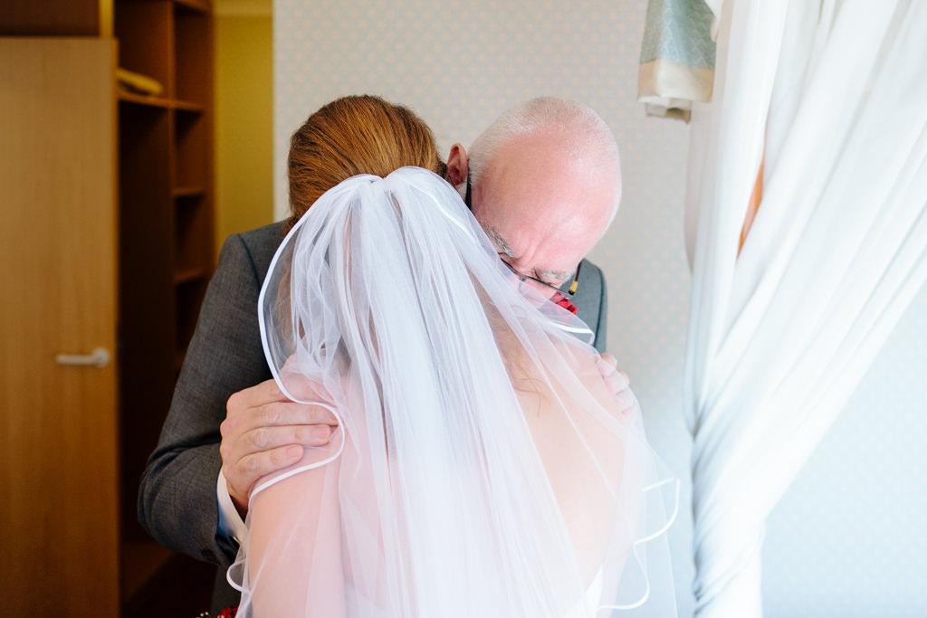 Norfolk wedding photographer slideshow father hugging bride