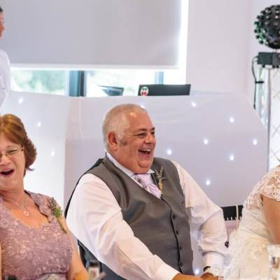 Norfolk wedding photographer – father of the bride laughing