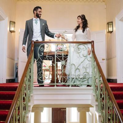 Norfolk wedding photographer – bride and groom at top of stairs