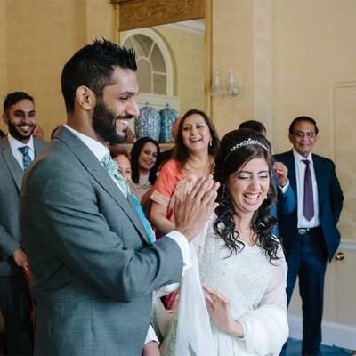 Norfolk wedding photographer – bride and groom high five