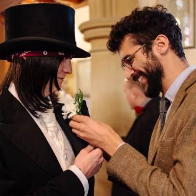 Norfolk wedding photographer – helping groom with flower