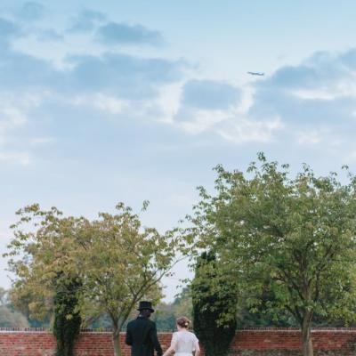 Norfolk wedding photographer – bride and groom walking moon