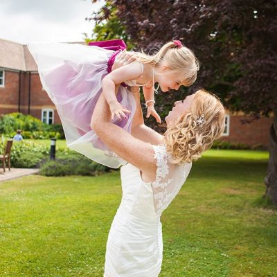 Norfolk wedding photographer – bride mother and daughter lift
