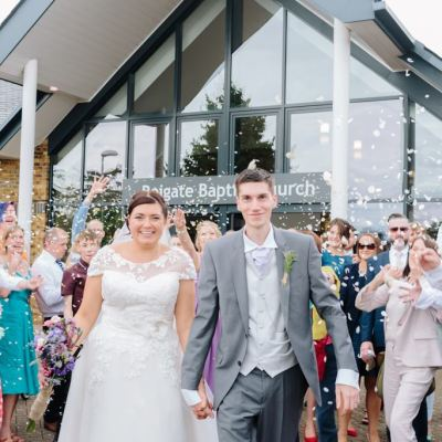 Norfolk wedding photographer – bride and groom Reigate Baptist Church