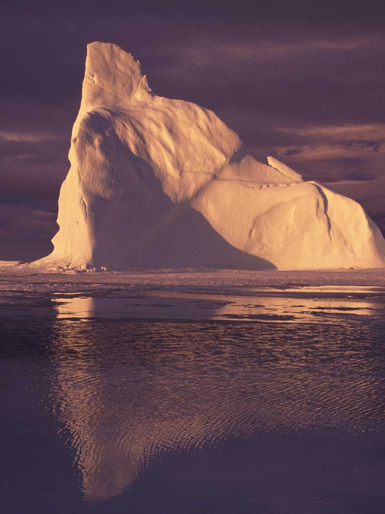mage showing iceberg off Baffin Island, Nunavut, Canada with meltwater ponds in the foreground. Arctic warming has been associated with a rapid decline in Arctic summer sea ice extent. Image credit- Sandy Briggs
