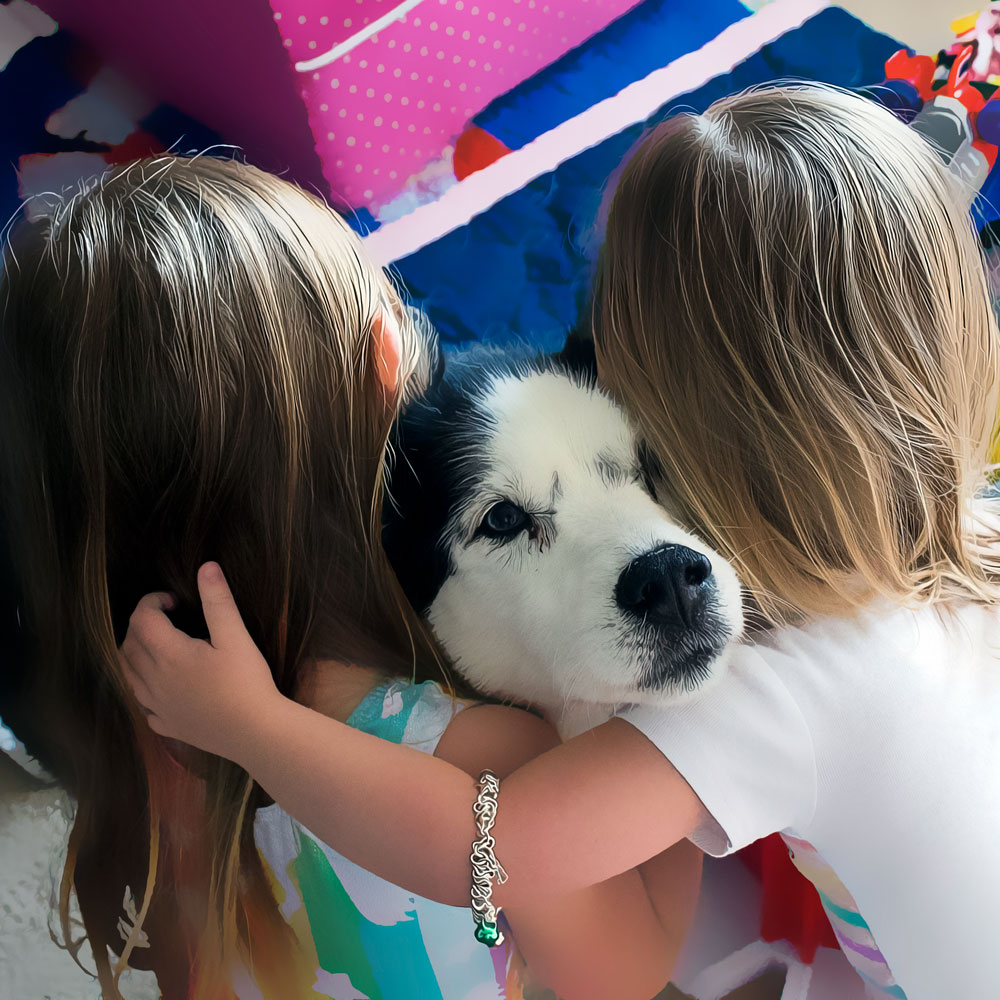 photo of 2 children hugging dog
