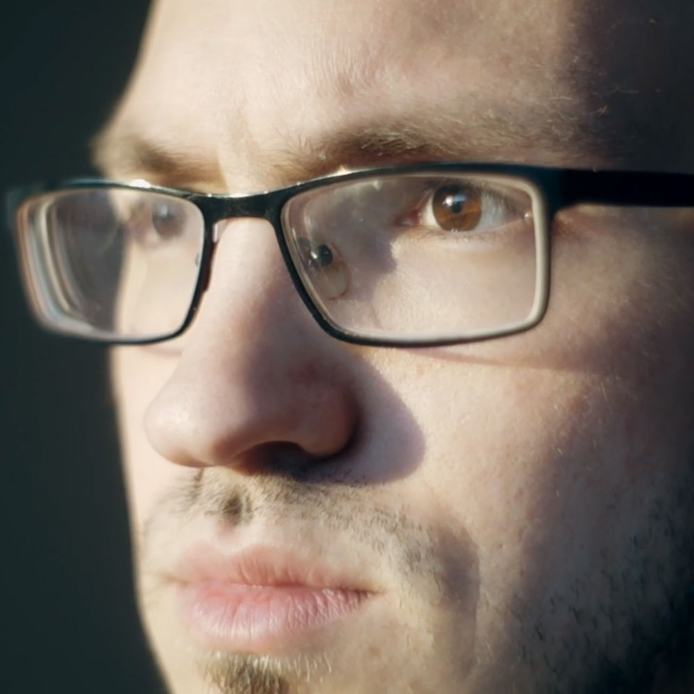 face of man with glasses