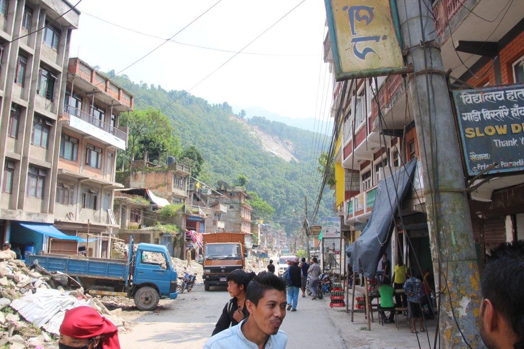 On the edge of town, a small landslide that acts as a reminder