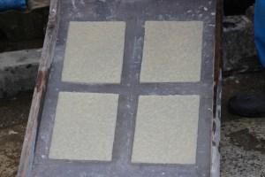 Paper sitting on silk screens