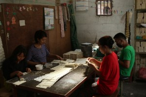 Workers assembling another product, in another factory.