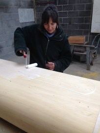 Louise gluing the 2nd layer of Fine grade ply to the curved wall