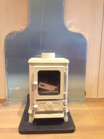Backplate installed and slate stove base in place