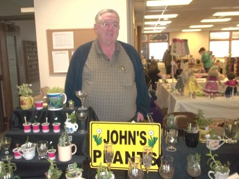 John selling his plants at Trinity UMC