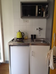 A mini-fridge and a cupboard held everything we would need to make simple and inexpensive meals.