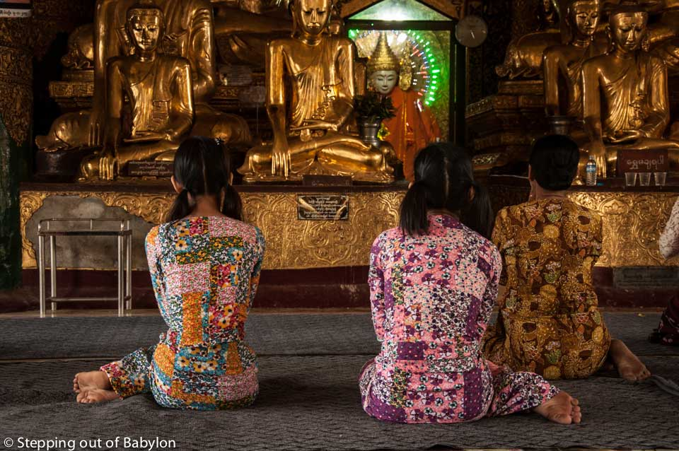 Praying at on of the temples of Shwedagon Pagoda