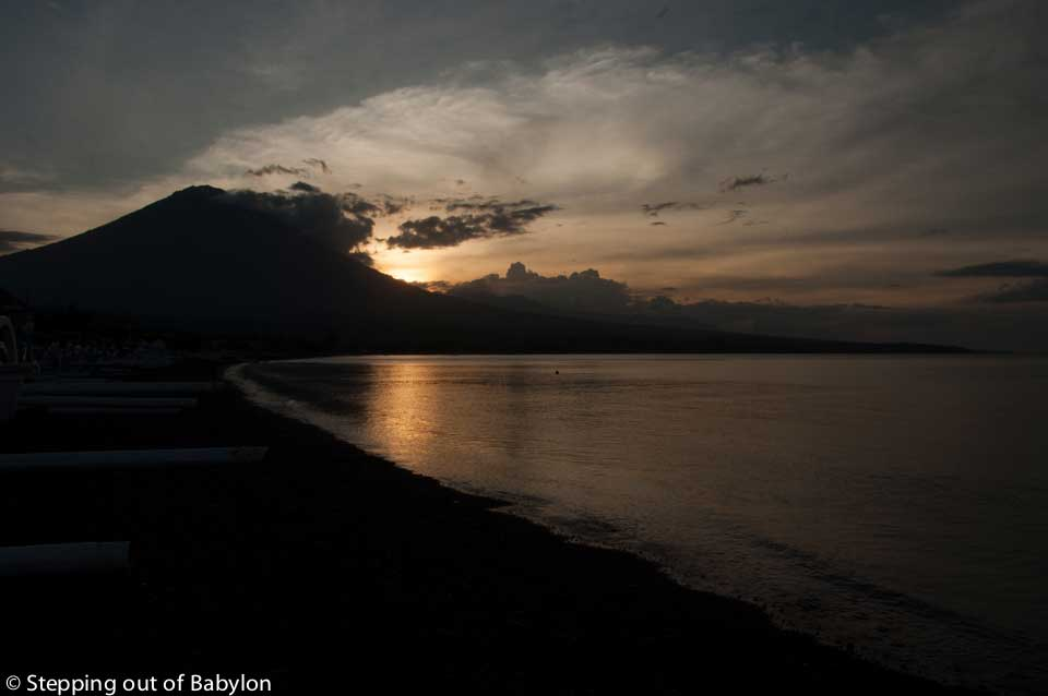 Amed beach with Mount Angun at the sunset, Bali