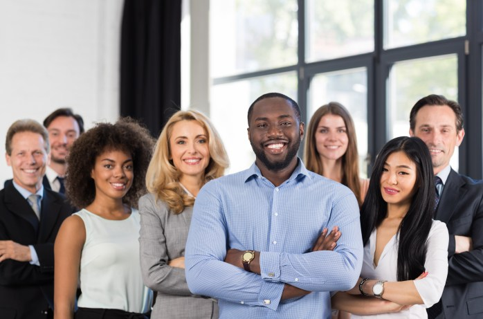 African,American,Businessman,Boss,With,Group,Of,Business,People,In