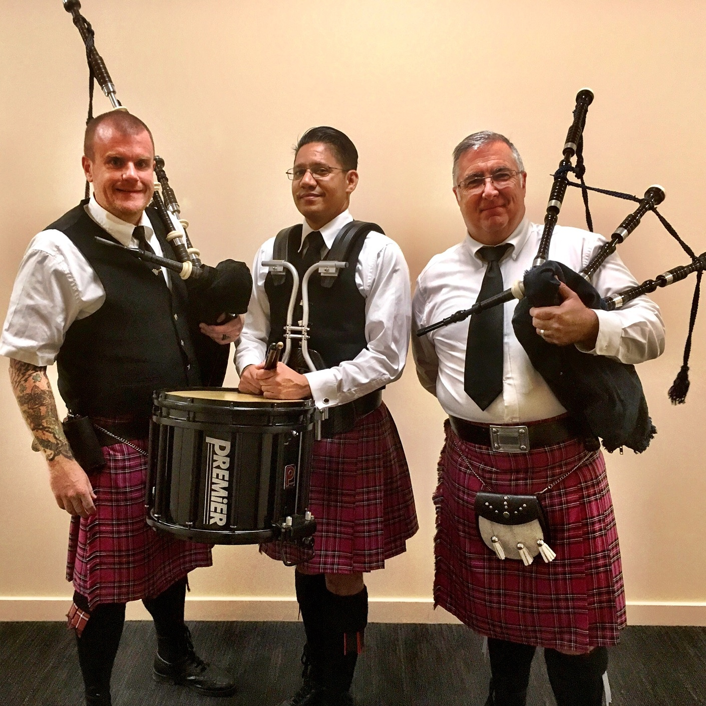 image of 3 pipers at Breast Cancer Fundraiser–Pink Kilts!!