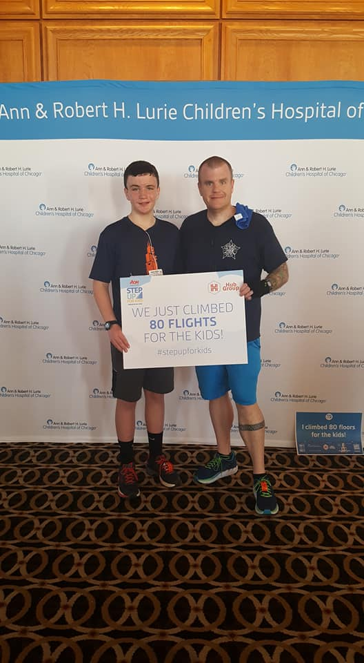image of steve and son after completing a climb at aon chicago