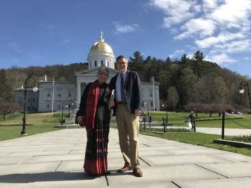 Matthew Derr with Vandana Shiva in front of the Vermont statehouse