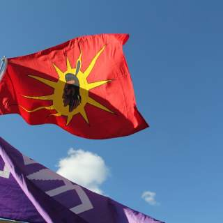 Mohawk and Iroquois Confederacy flags at a march in Montpelier protesting the Dakota Access Pipeline