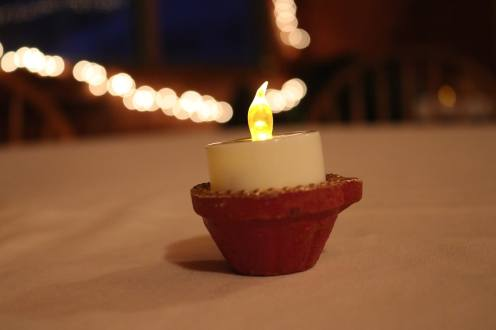 A close-up of a flickering candle used to celebrate the festival of lights, diwali.