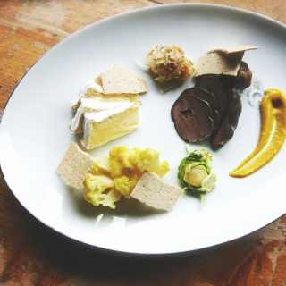 a plate of assorted foods assembled beautifully
