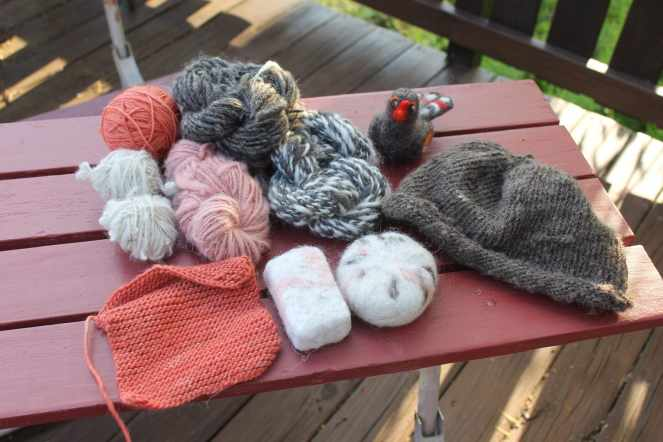 Hand-spun, hand-knit final products from the Introduction to Fiber Arts class