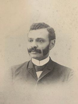 A black and white portrait of George Washington Henderson, a freed black man who founded the Craftsbury Academy.