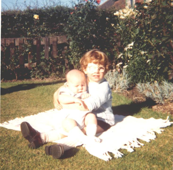 Me holding my baby brother Alan. I was probably about 3 years old and this was taken in my Grandma and Grandad's garden. Note the corrective eye patch and brown shoes