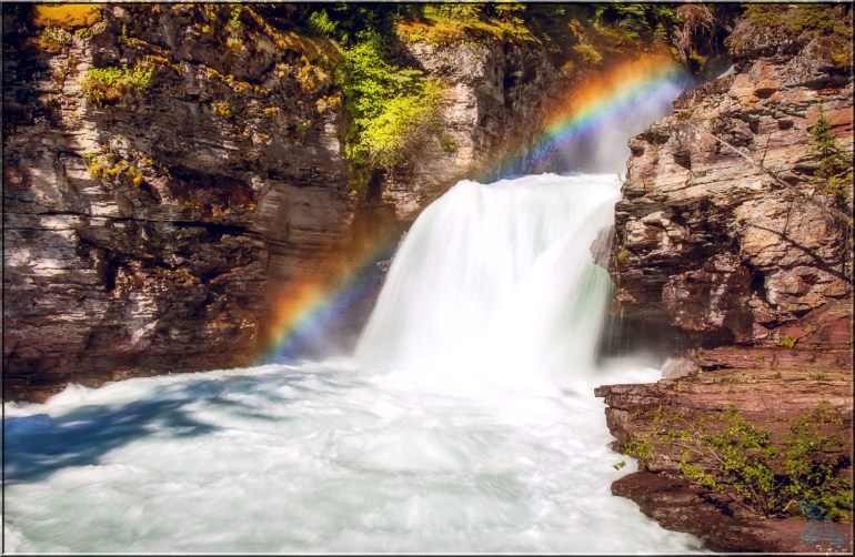 St. Mary Falls in Glacier National Park. We got there at just the right moment--as the sun peaked above the mountains and produced this amazing rainbow.