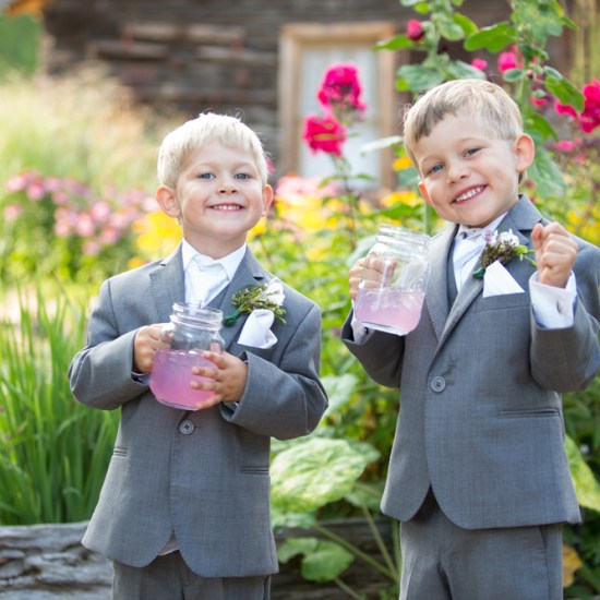 Ring bearers, grey tux, pink lemonade favor, garden wedding