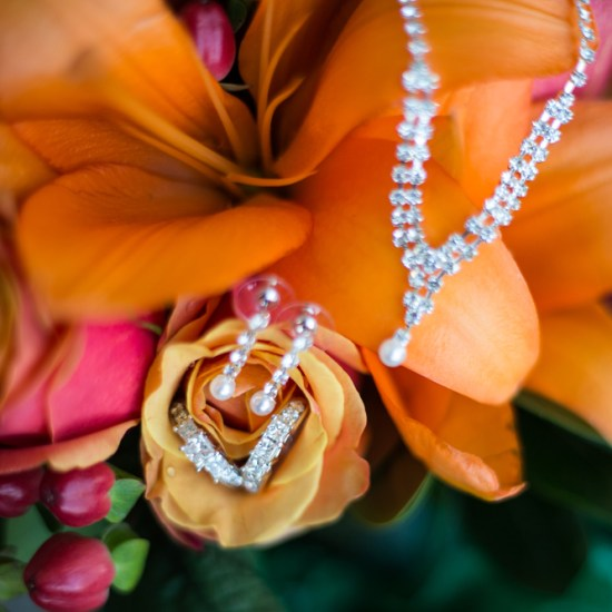 bridal jewelry, orange flower boquet