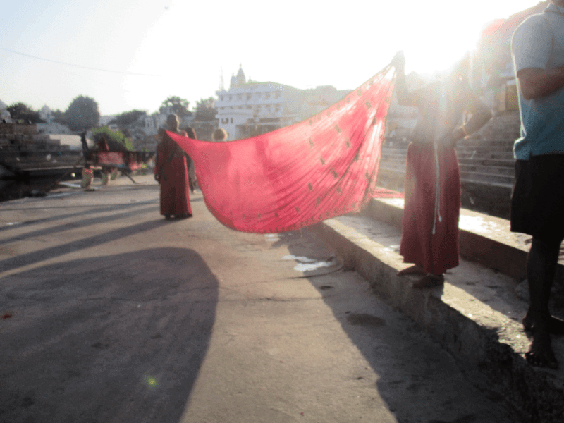 After bathing in the holy lake, saris must be dried.