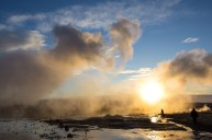 The steam of a Strokkur Eruption at Geysir, Iceland - The sun is at it''s zenith