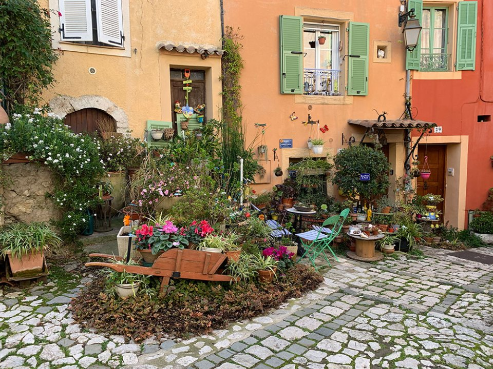 Steve & Carole in Vence - A lovely little square in the center of Falicon where the house owners have created their own little urban gardens.