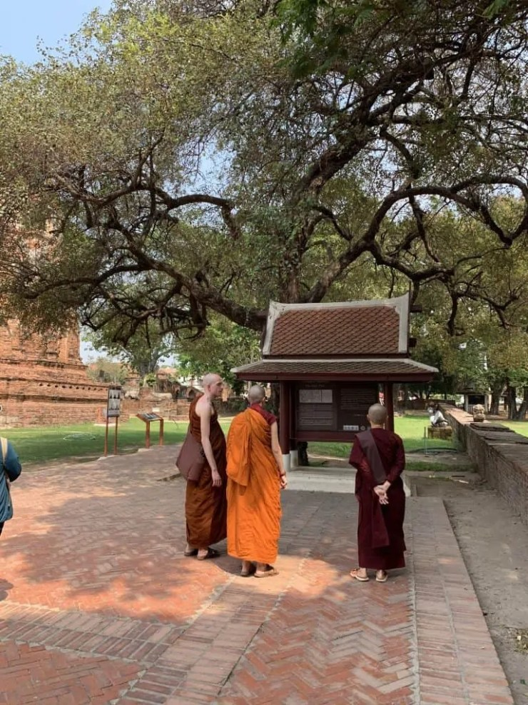 monks visiting the temple, two are females