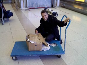 Busted box of CDs upon return (Winnipeg Airport)  See what happens when you don't buy at concerts?  Eh?!!