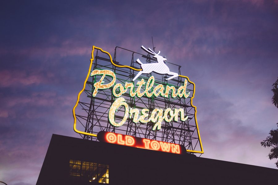 "A stylized, neon ""Portland, Oregon"" Old Town sign"