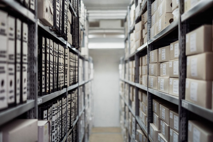One row in a document archive, full of boxes and binders