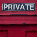 "A mail slot, just below a bold sign reading ""Private"""