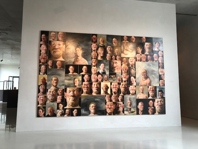 91 faces in this painting according to the description. I didn't verify that but feel free!