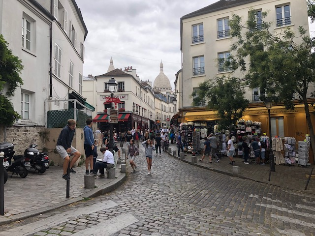 Fun intersection with Sacre Coeur in the background