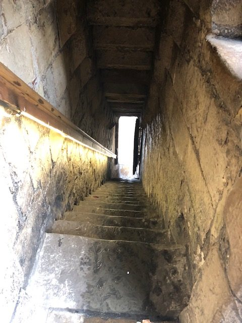 Very narrow stairs exiting the next gate