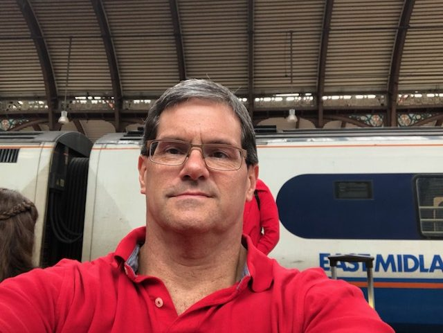 Selfie sitting on the train platform