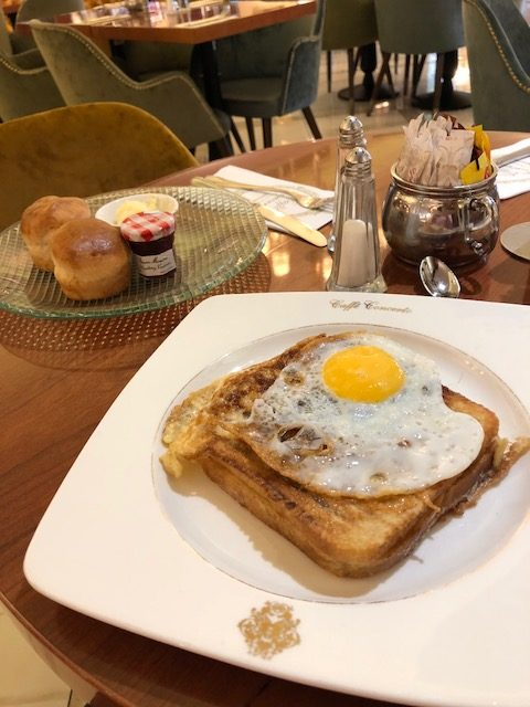 A Croque Madame and a scone with clotted cream