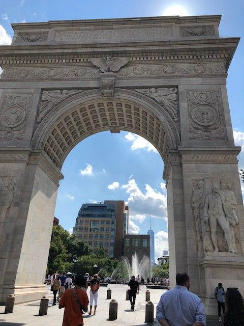 The arc in Washington Square, with the new World Trade Center in the background