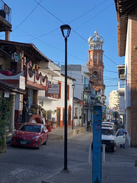 Gaby's restaurant (again) and Our Lady of Guadalupe church in the background.