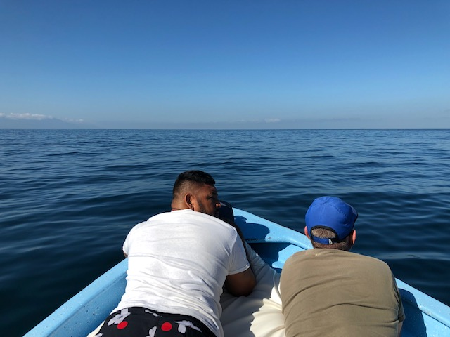 Juan and Christopher relaxing on the front of the boat
