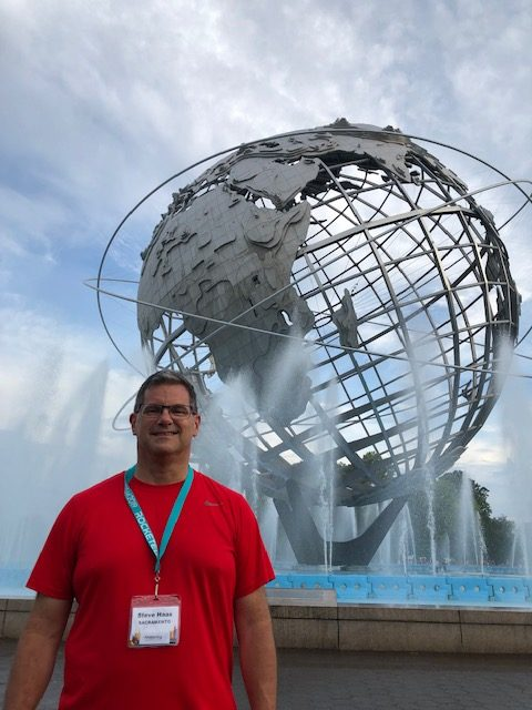 Me at the Unishpere - a huge hollow globe sculpture in an even bigger water fountain